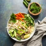 five spice chicken bowl with carrots and cucumbers