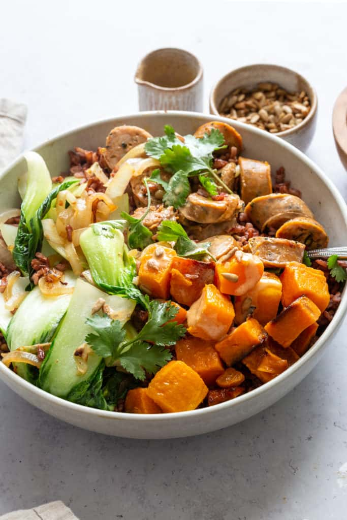grain bowl with rice, sausage, butternut squash and bok choy